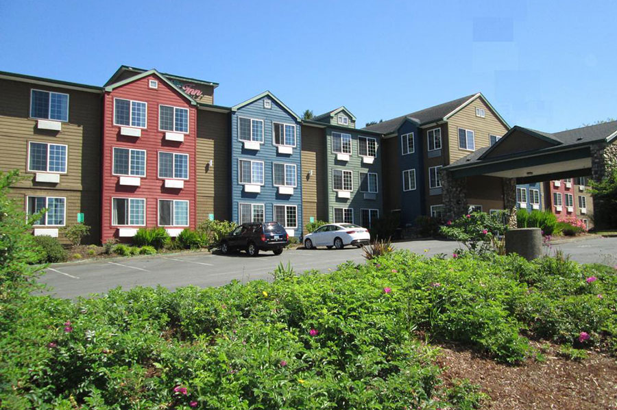 colorful exterior buildings of The Ashley Inn & Suites